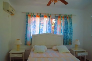 Beachfront villa with separate guesthouse in gated community