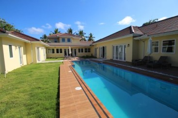 Beautifully designed mansion in select community close to the beach