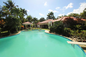 Magnificent residence in popular gated beachfront community